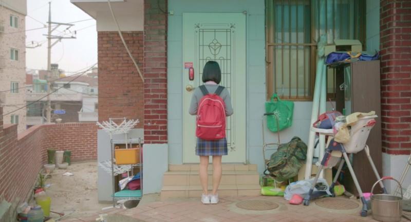 GIRL AT THE DOOR
